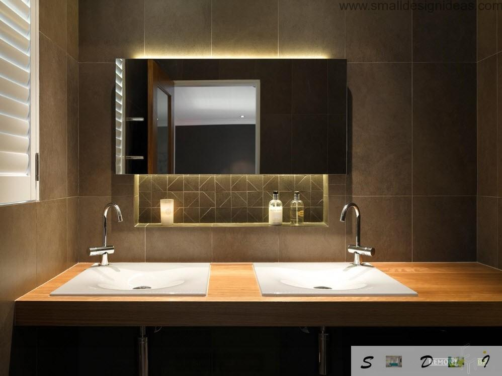Countertop with 2 sinks in the black decorated bathroom with mirror lights