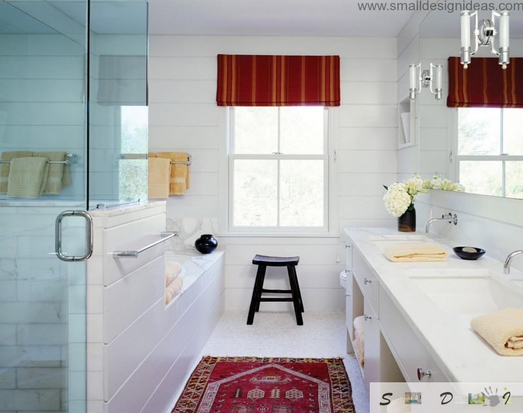 Designers even were able to lay a rug on the floor of the white bathroom