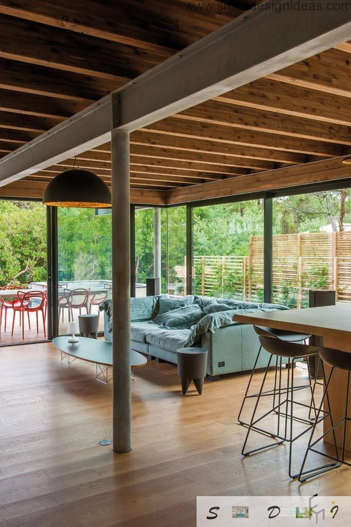 Outside wooden terrace also can transform into cozy living room thanks to modern furniture and a bar