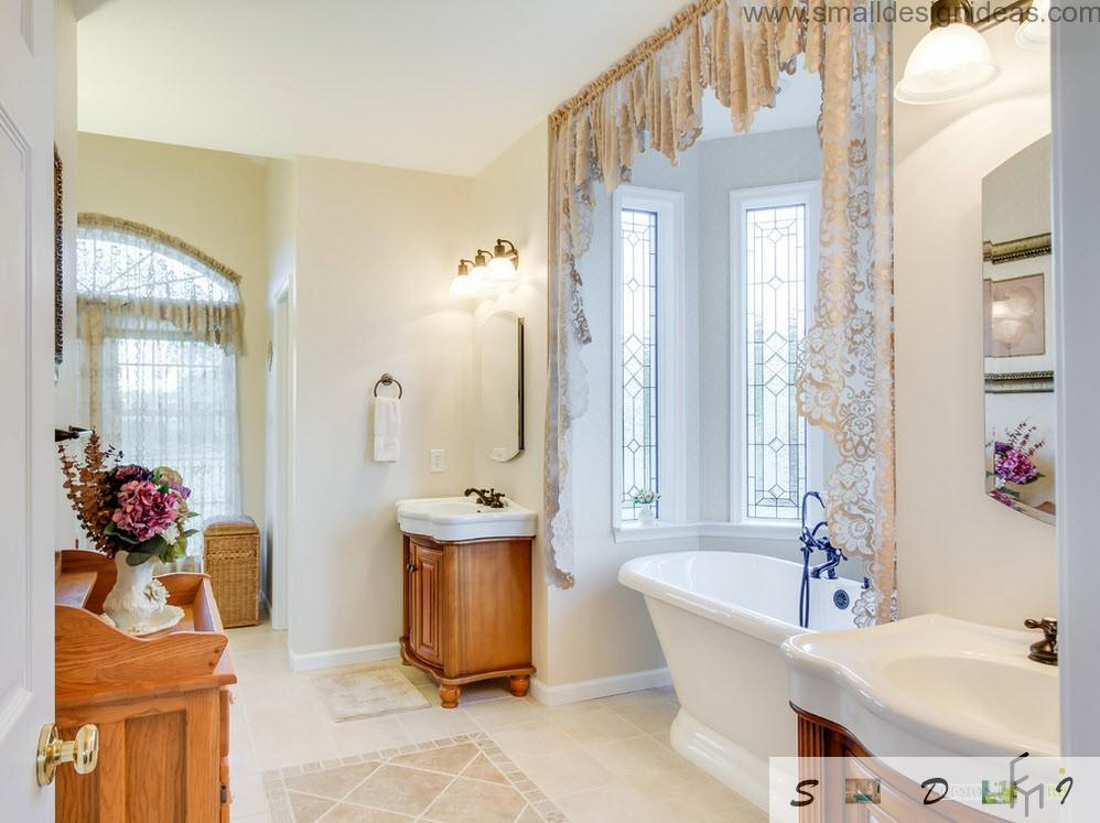 Wooden pieces of furniture in the classic and full if light bathroom design