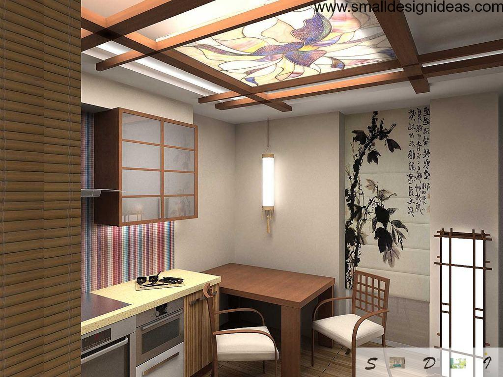 Dining zone decorated in the apparent Japanese style with floral ornamentation, paintings and wooden furniture