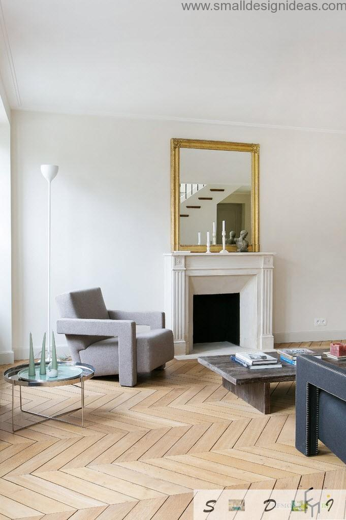 Mirror and fireplace near the armchair in contemporary design of the livin room