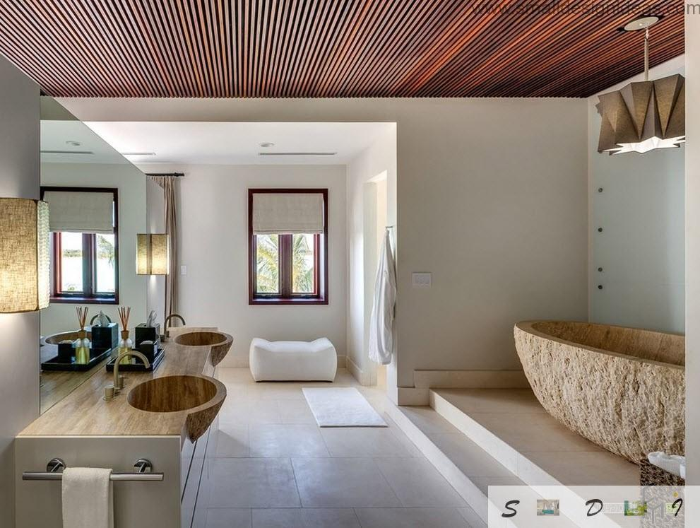 Wooden countertop with carved sinks in it looks very premordial and thus very attractive