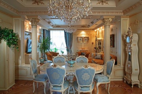 Barique dining room in the spacious suburb villa with columns and royal blue sheathing of chairs