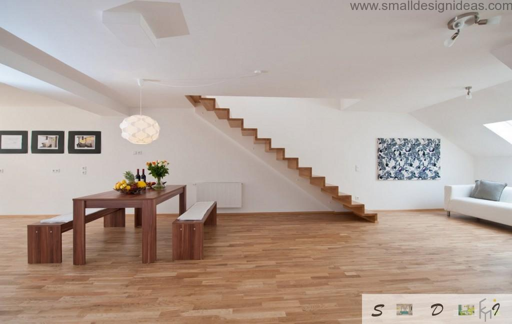 Unusual use of the stairs in the white and wooden theme of modern living room interior in the private house
