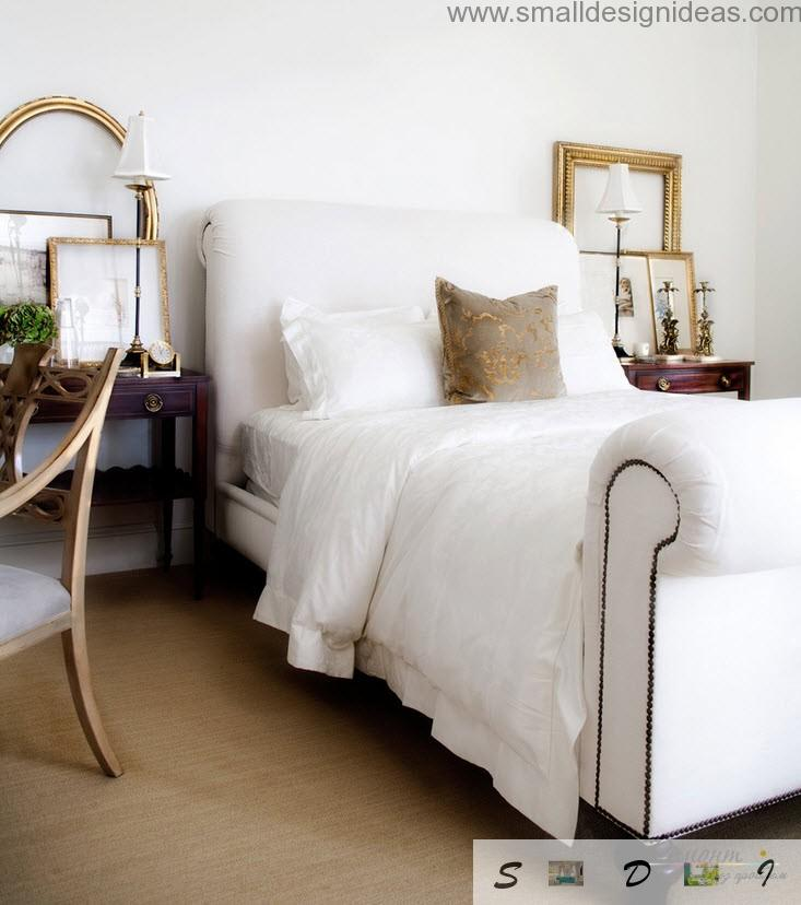 White luxurious bed and wooden furniture in the bedroom