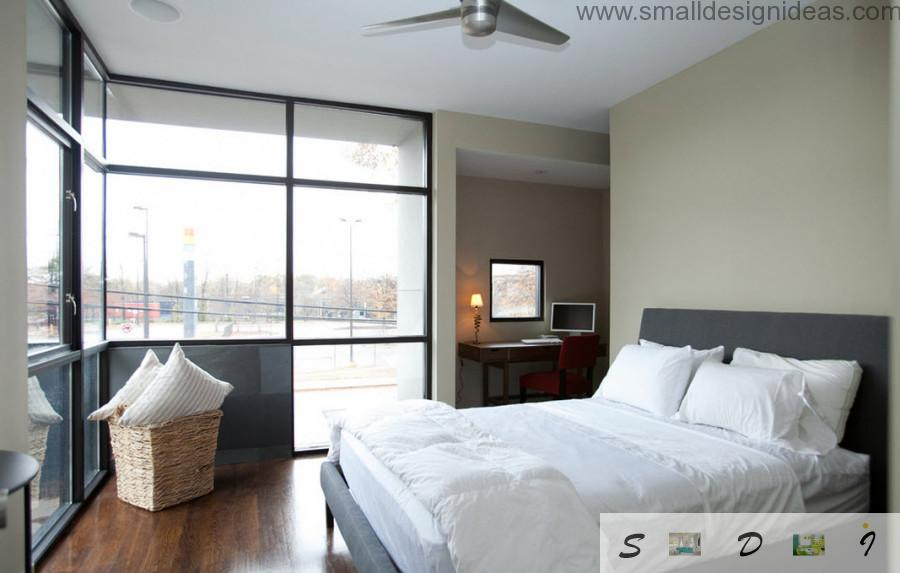 Modest lamp is wnough for lighting the bedroom when you have such big windows