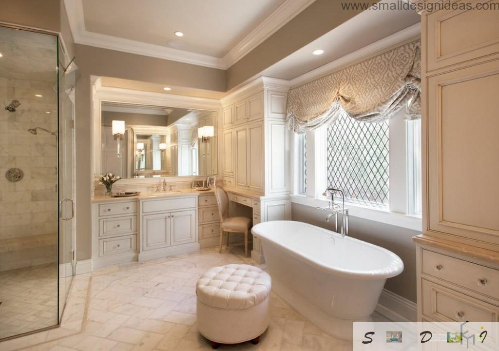 Chic and fashionable bathroom design with lambrequins and soft puff in front of oval ceramic bathtub