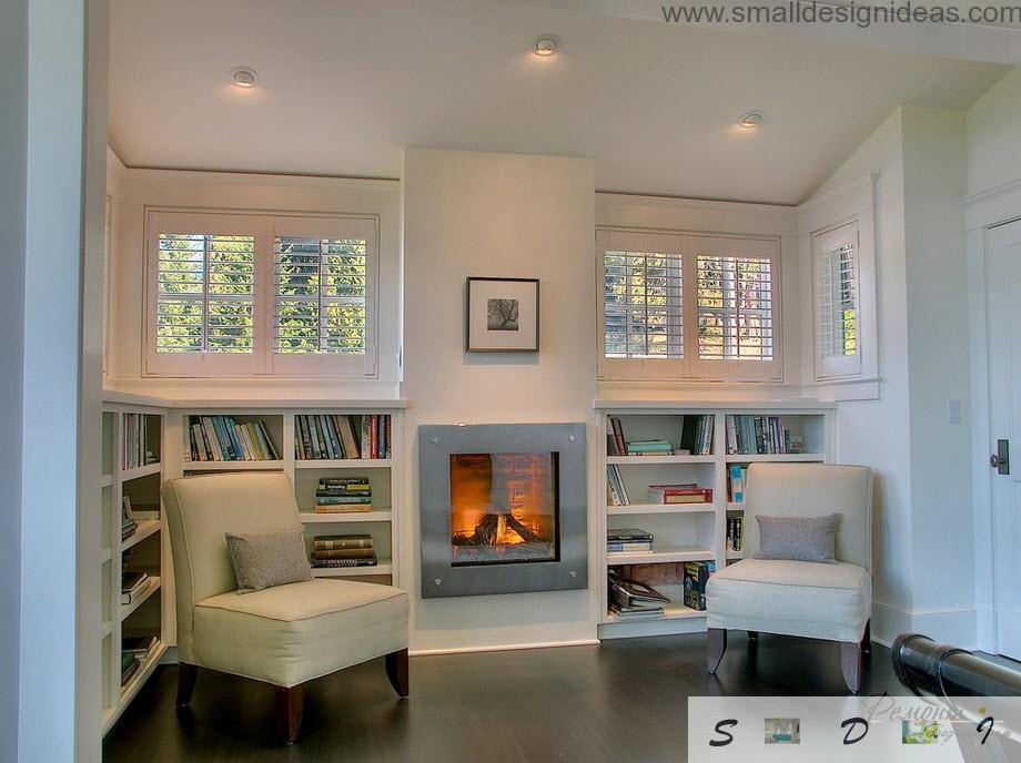 White living room-libraru with the fireplace and cozy white chairs for rest