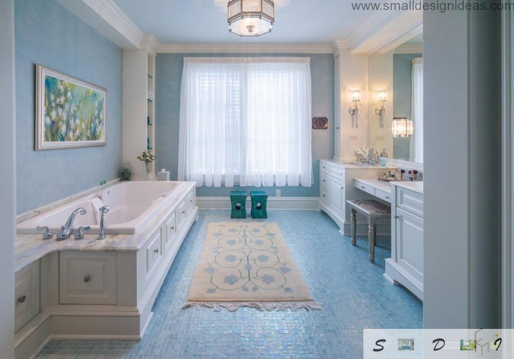 Blue mosaic tile floor and strict lines in the classic bathroom