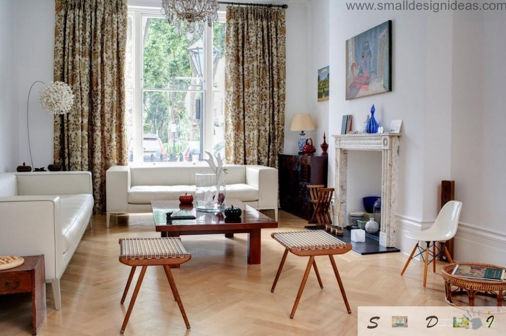 upholstered sofa and wooden chairs in the Scandinavian interior if the living room