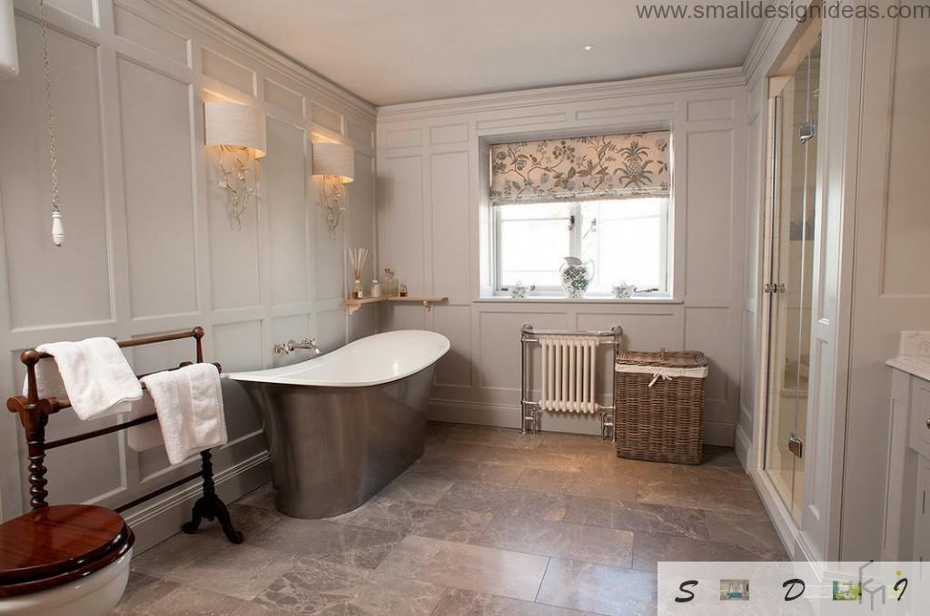 Steel glossy bathtub surface decorating th noble marble if the bathroom