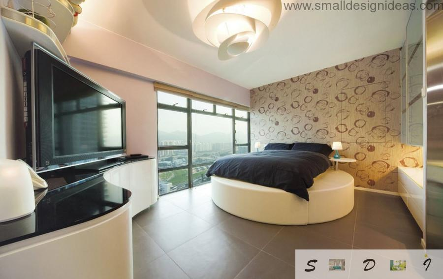 Round bed and panoramic window in the ultramoden bedroom