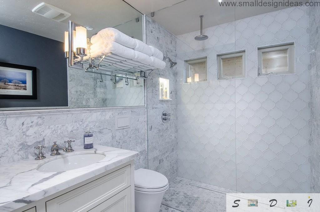 White interior of the bathroom with steel, plastic, tile and plaster