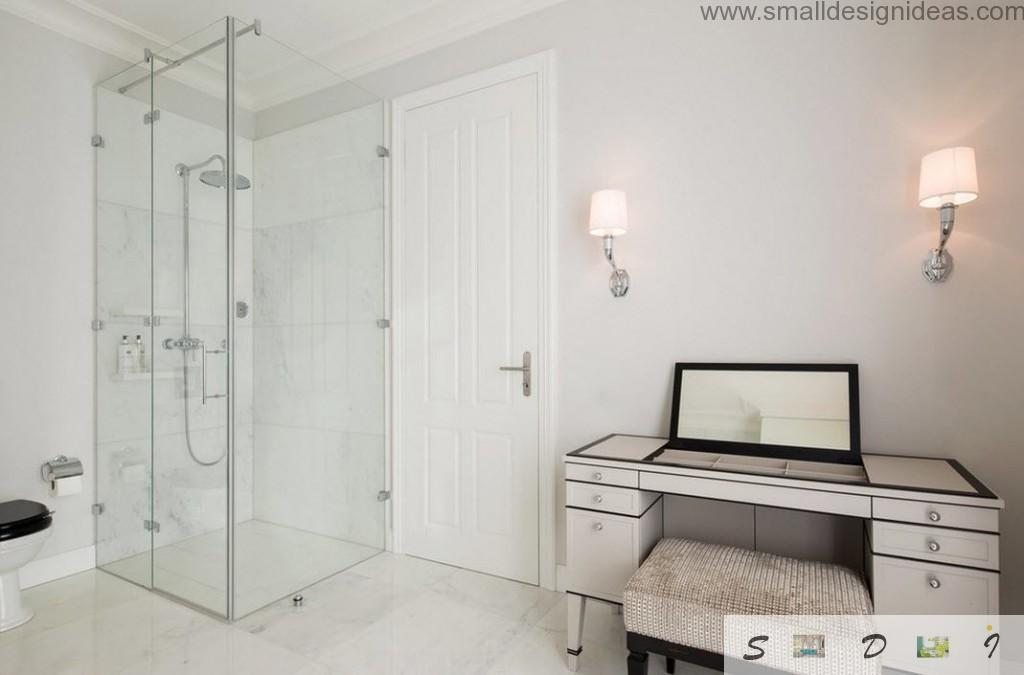 White bathroom with glass cabine for taking shower