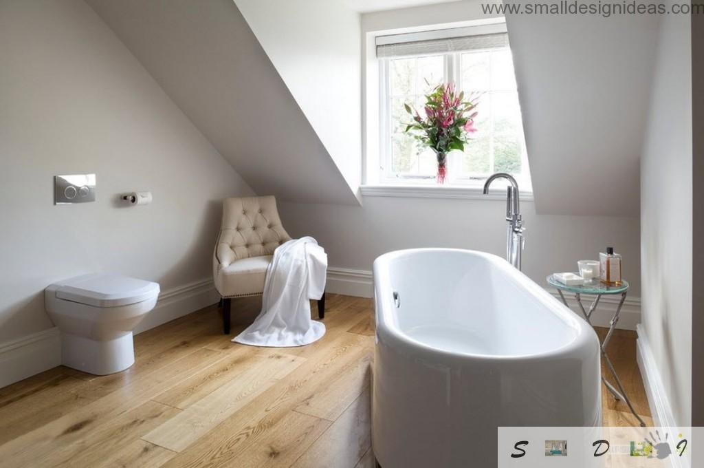 Vaulted ceiling in the royal white bathroom with light laminated floor