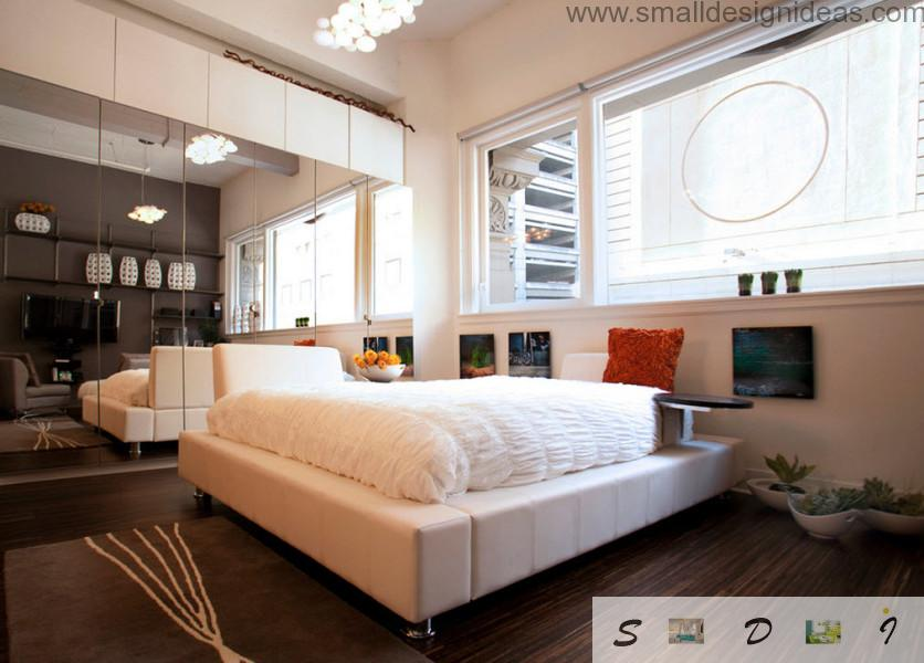 white terru maress on the orthopedic bed in the austere Scandinavian bedroom with wall-height mirror