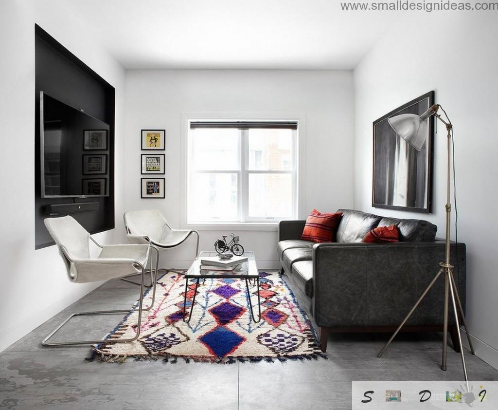 black uphosltered furniture as a contrast to white living room