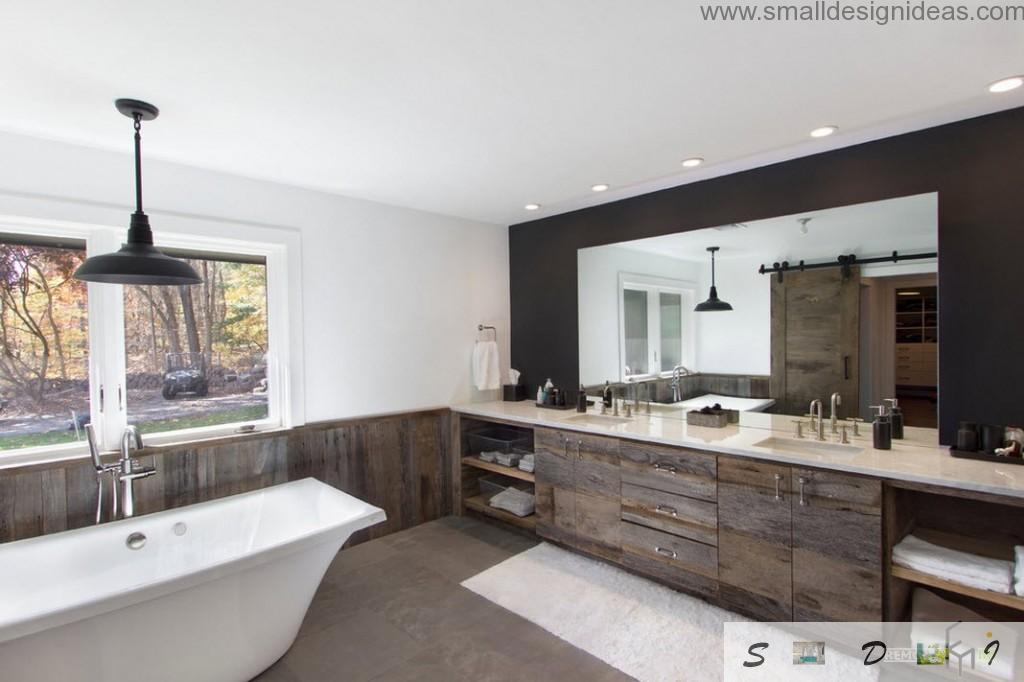 Wooden chest of drawers and white contrary wall trimming and classic bathtub shape in the bathroom