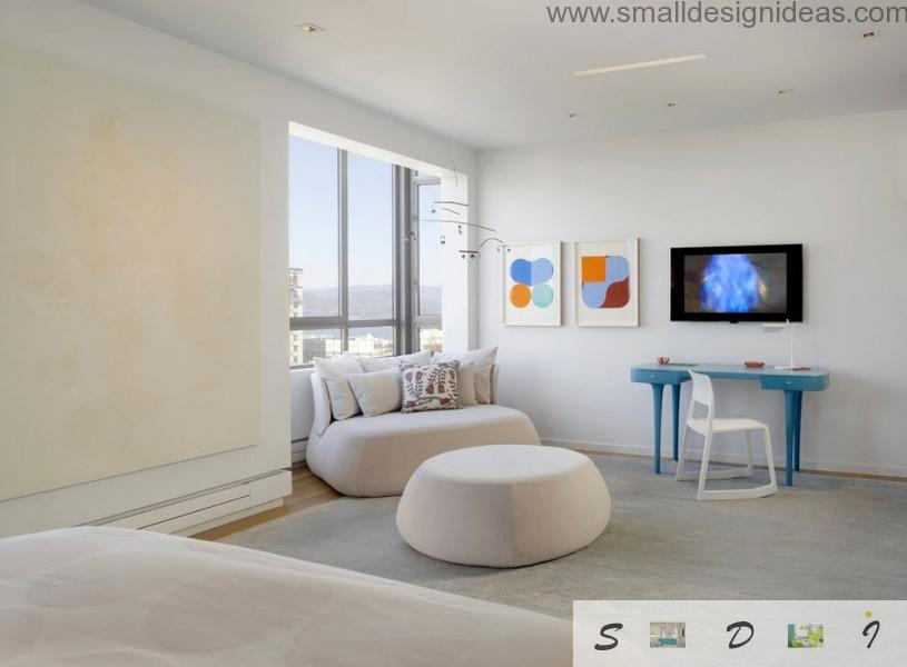 round puff in a center of the room and a round bed make create an atmosphere of freshness in modern bedroom