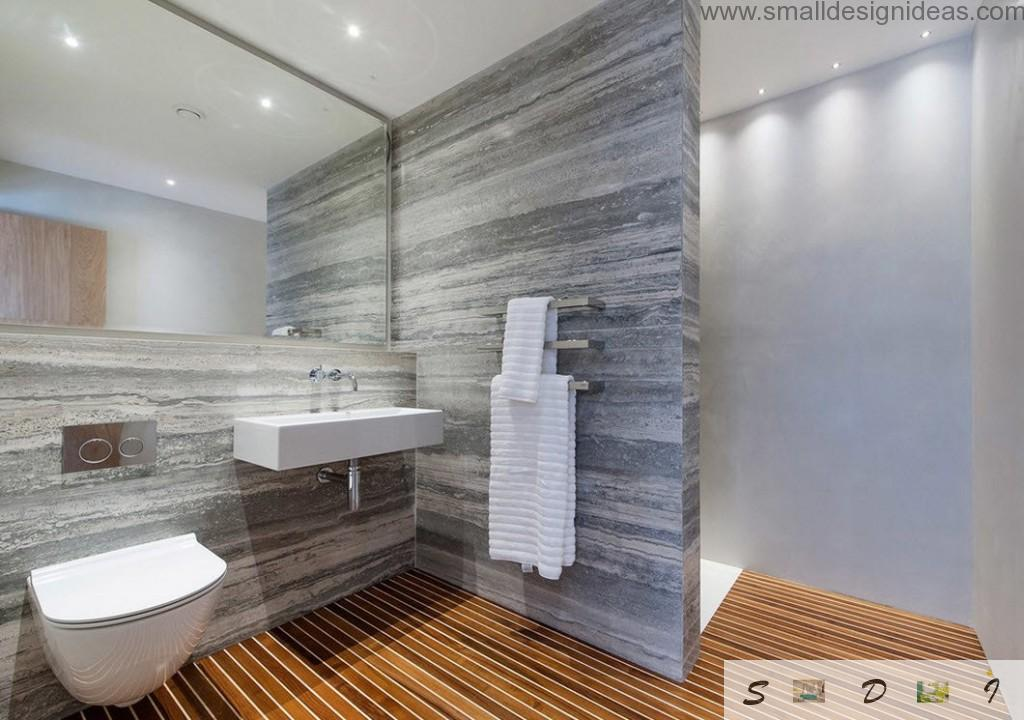 Grey textured trimming of walls with wooden imitation of the floor in the bathroom