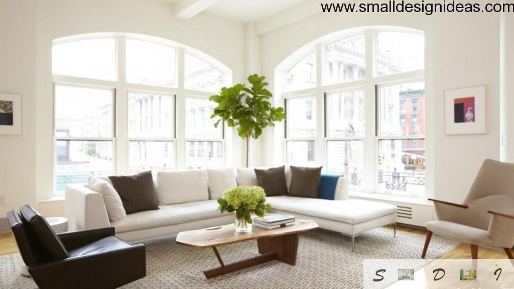 Bright joyful white room doesn`t look sterile with green additions to the interior
