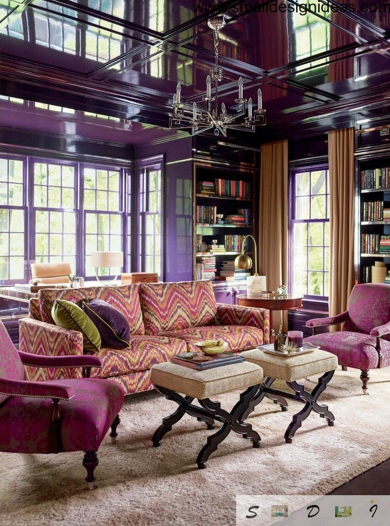 Purple eclectic design with creamy colored soft tables in front of the sofas and armchairs
