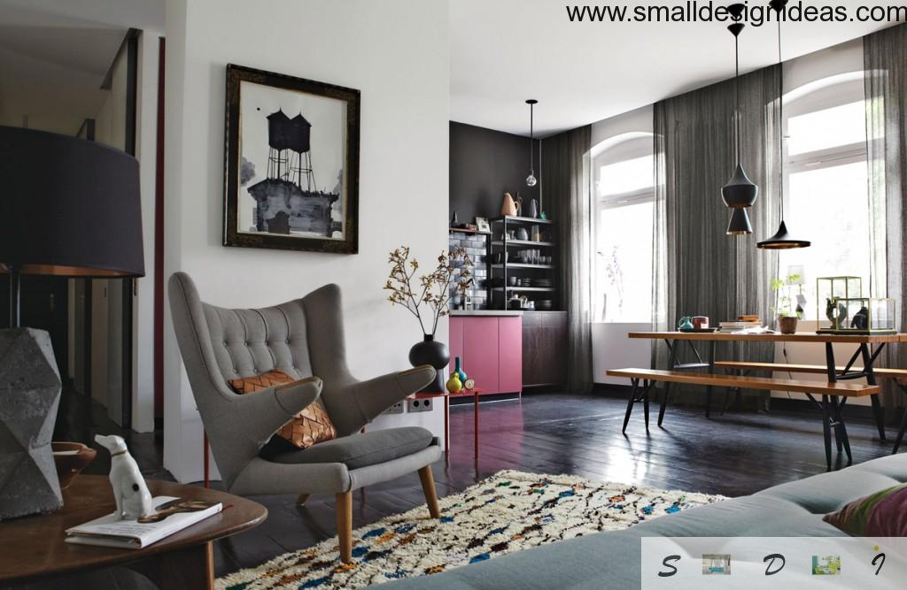 Combined eclectic living room space design with picture and cozy armchair