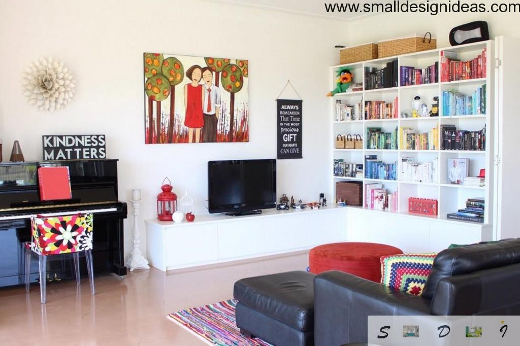 Discreet eclectic interior in the light colored living room with the picture of family on the wall