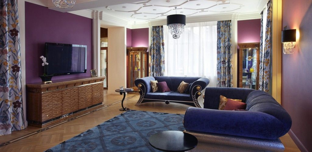 Relaxing zone with blue couches in the Art Deco Interior Design Style
