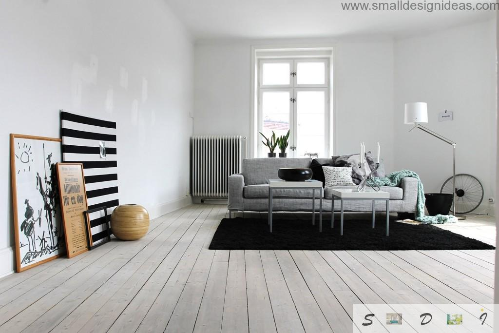 Austere scandinavian design in th white and black tones for the living room with wooden floor