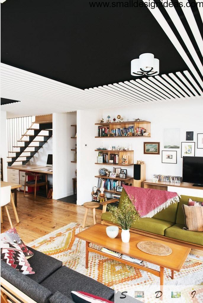 Black and white living room ceiling with contrast to the wooden floor in eclectic design