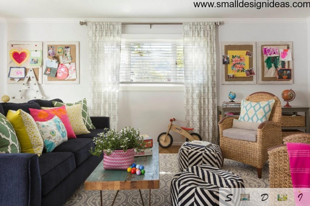 Black and white zebra puffs in the eclectic design of the living room with wide window