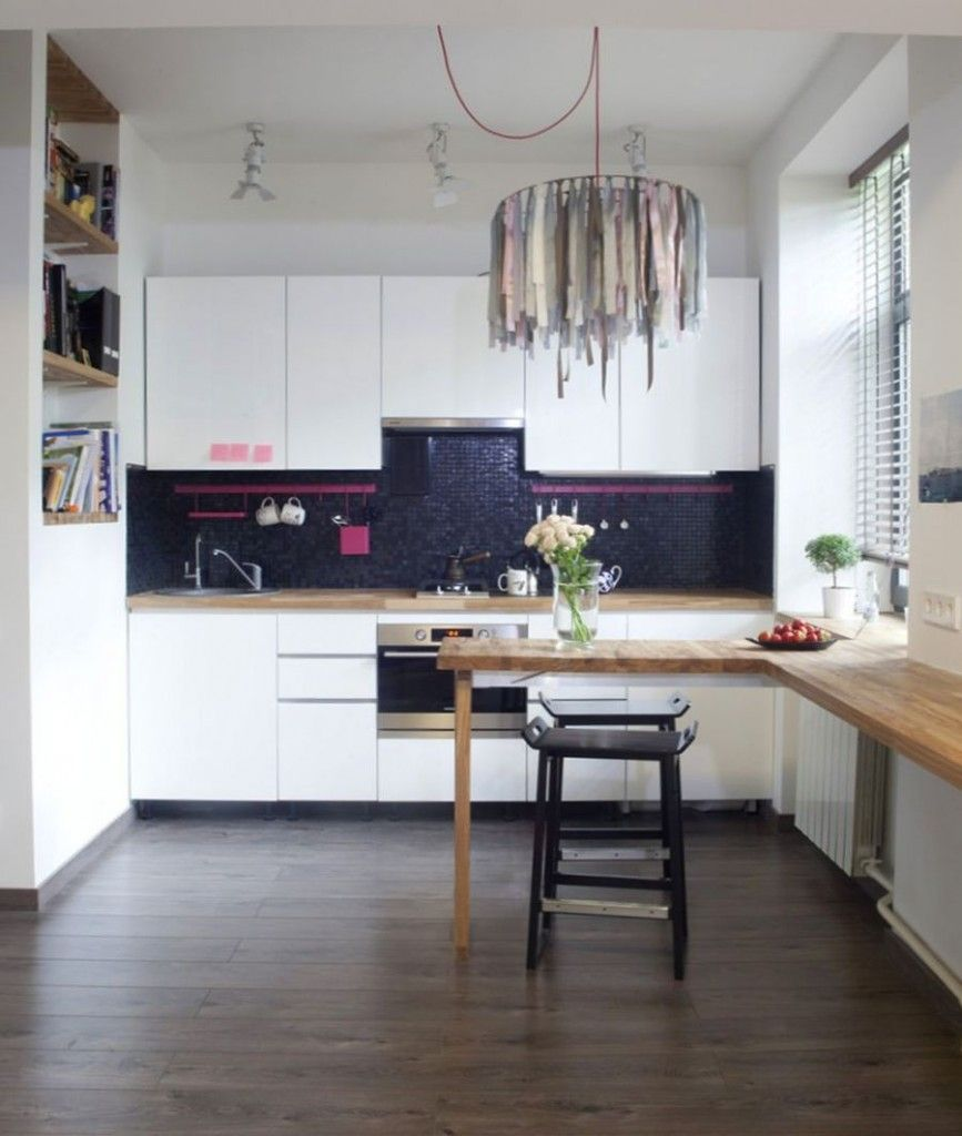 Minimalistic interior in the small kitchen with contrast and textiled unusual chandelier