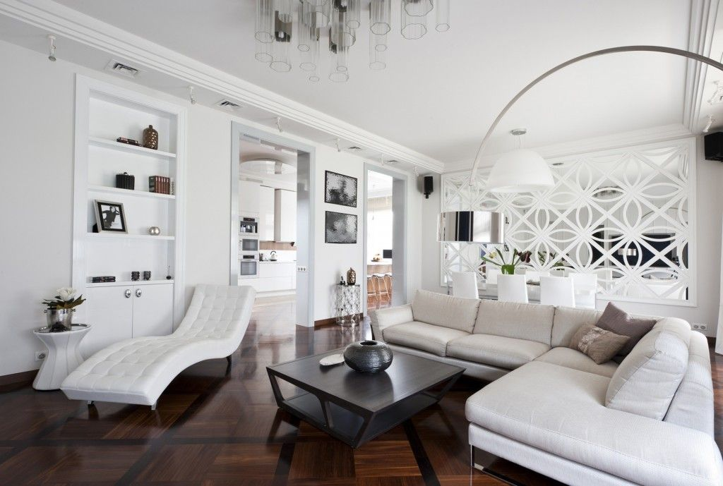 White Art Deco relaxing zone within spacious living room with dark floor and coffee table