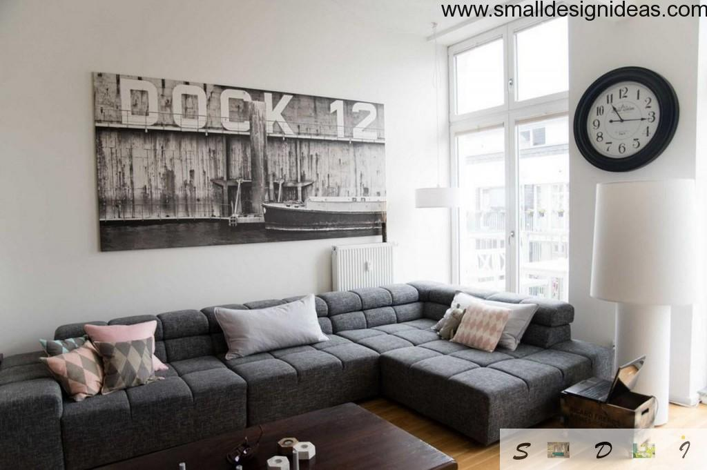 dark furniture and poster in the white eclectic living room interior