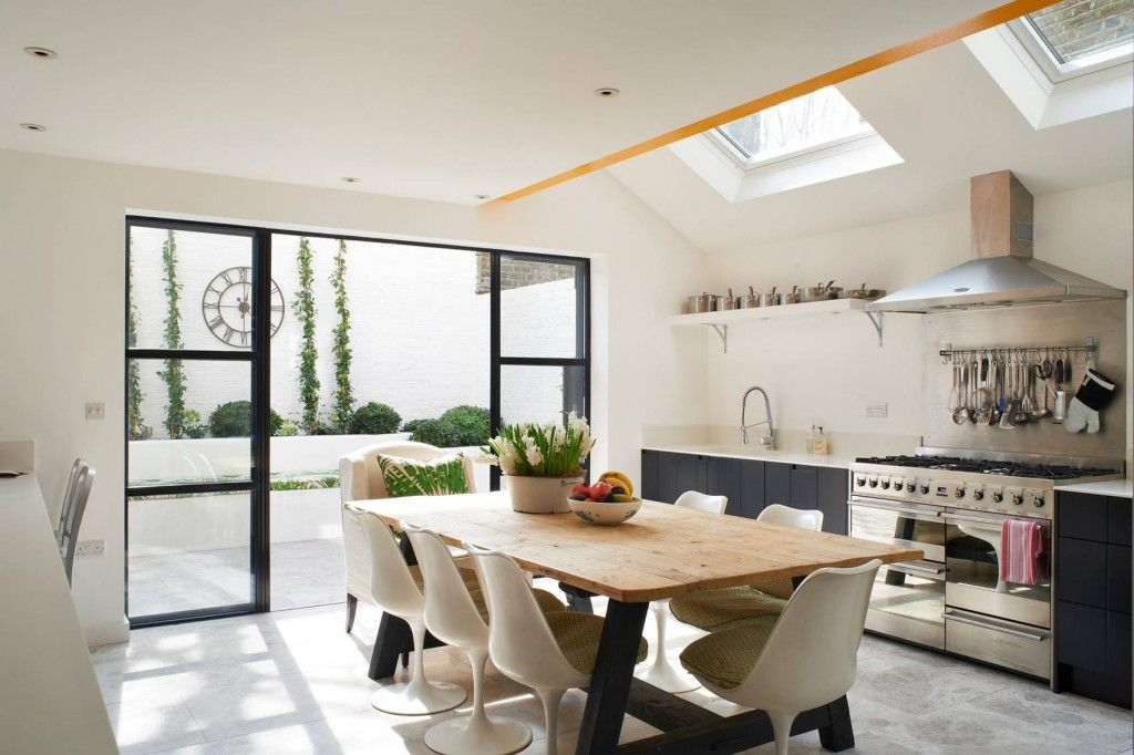 Eclectic interior of the bright light kitchen with ecological motives