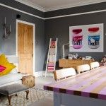 Garish colors and unexpectedly bright furniture in dull interior - it`s Kitsch