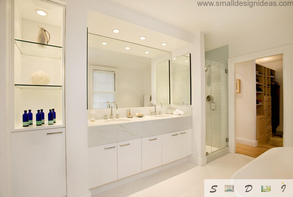 Large mirror as a focus of the white design of the bathroom