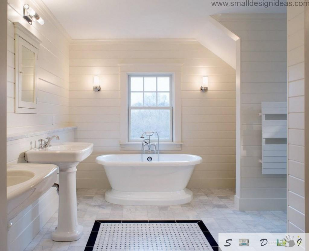 White furniture and trim in the tiled white bathroom