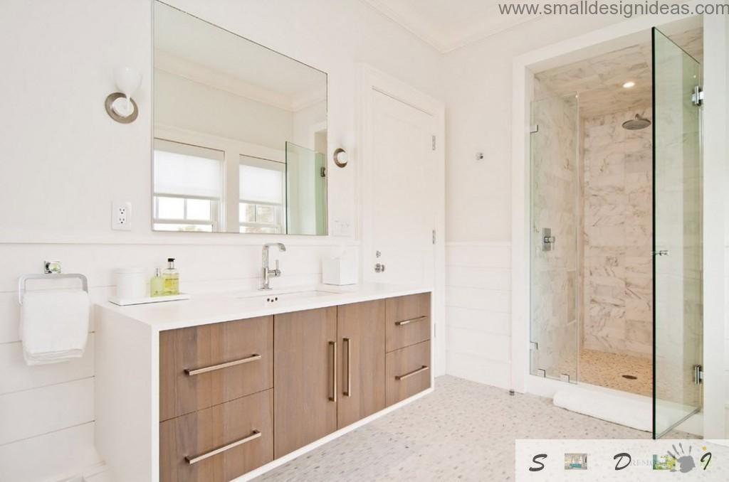 Nice wooden storage lockers and nice glass cabin for shower in the bathroom