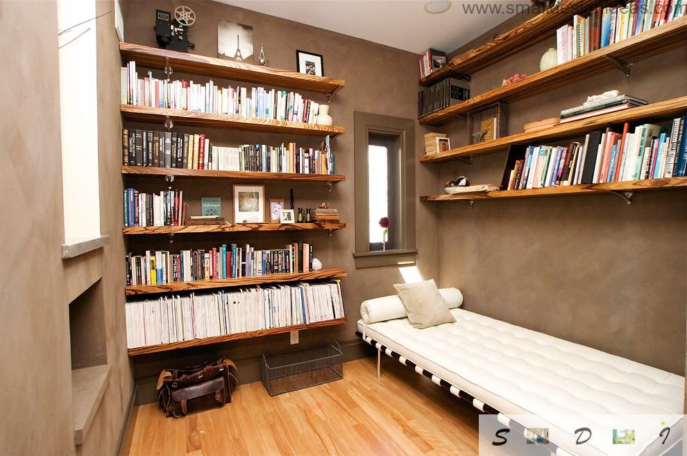 Tiny living library with the ascetic bed