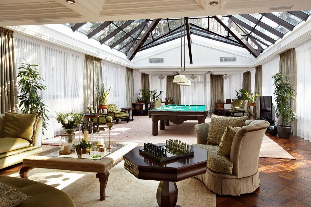 Chic view of the villa with eclecticism of the living room with glass roof