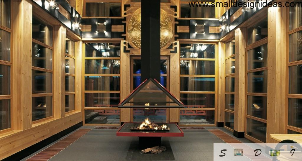 Fancy exhaust hood of the open hearth in the big glass and wooden veranda of the village house