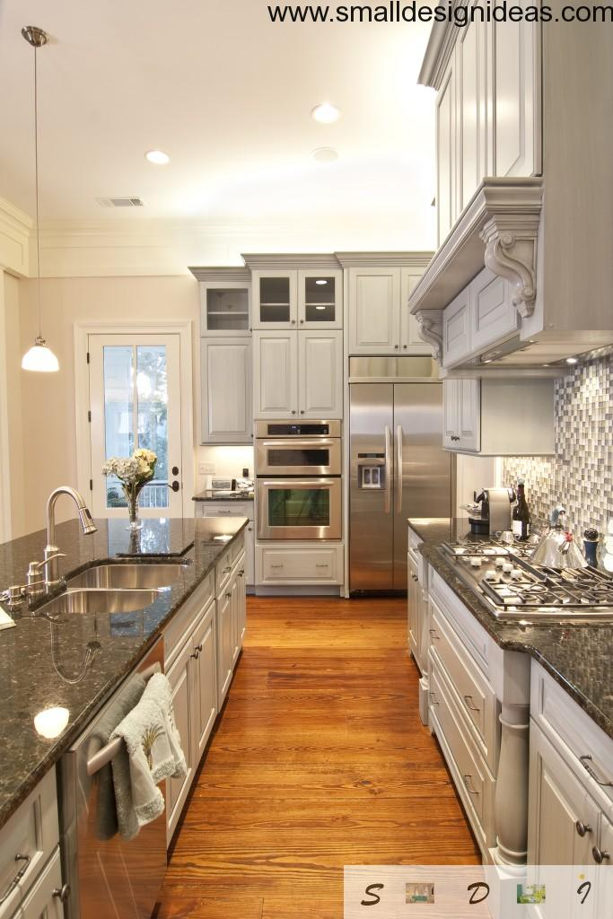 real galley kitchen with steel glossy surfaces and all contemporary kitchen appliances