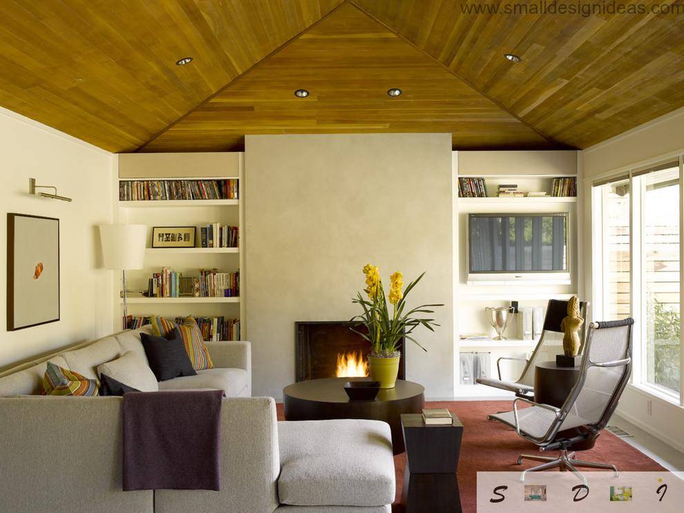 Wooden vaulted ceiling in light tones and creamy walls make small living room optically bigger