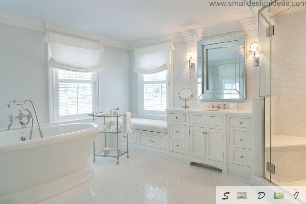 Absolutely white interior of the bathroom don`t looks sterile cause of the lighting