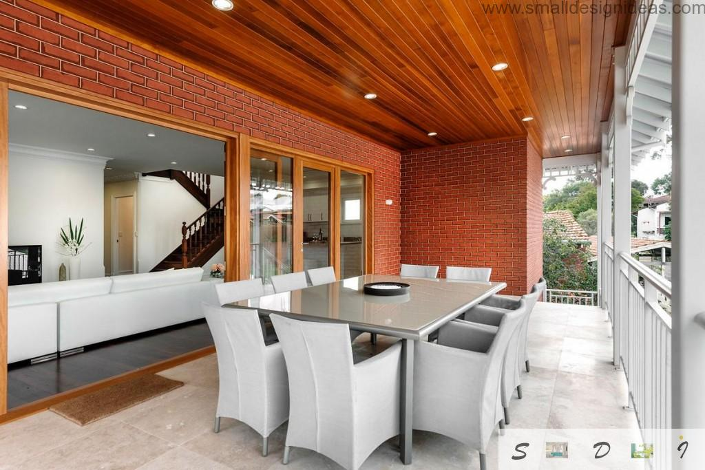 wooden themed separate dining zone in the veranda of the private house