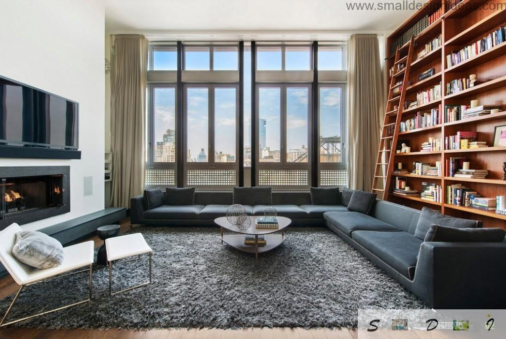 Unique interior of the living room combined with library of the huge space