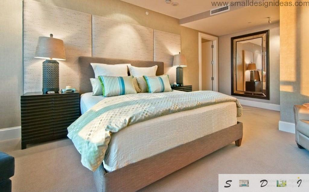 Warm modern interior of the men`s bedroom with platform bed with headboard and pervasive lighting